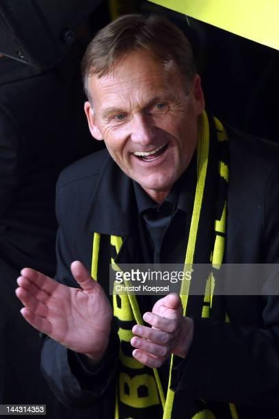 Chairman HansJoachim Watzke of Dortmund sings during a parade at Borsigplatz celebrating Borussia Dortmund's Bundesliga and DFB Cup win on May 13...