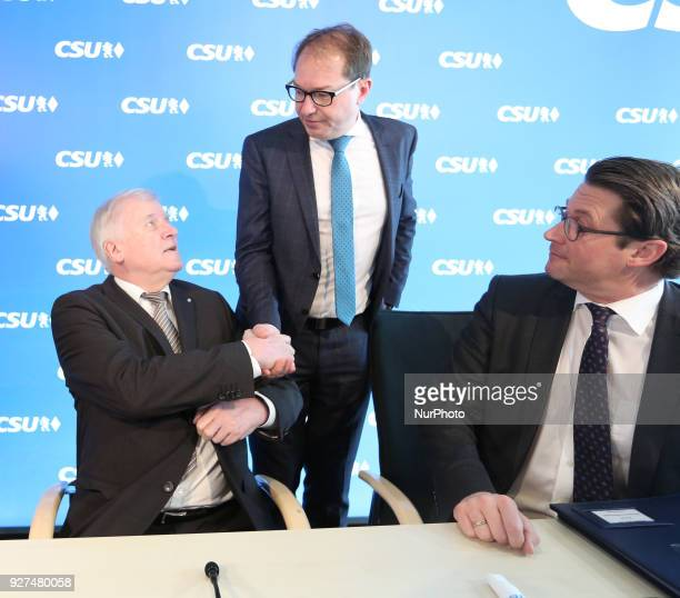 CSU chairman Horst Seehofer and State group leader Alexander Dobrindt talk to each other while CSU's secretary general Andreas Scheuer sits next to...