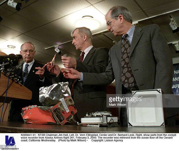 Chairman Jim Hall Left Dr Vern Ellingstad Center and Dr Bernard Leob Right show parts from the cockpit voice recorder from Alaska Airlines flight 261...