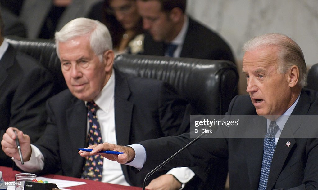 Chairman Joe Biden, D-Del., right, questions Armed Forces Commander in Iraq Gen. David Petraeus and U.S. Ambassador to Iraq Ryan Crocker as Sen. Richard Lugar, R-Ind., listens during the Senate Foreign Relations Committee hearing on 'Iraq: The Crocker-Petraeus Report'on Tuesday, Sept. 11, 2007.