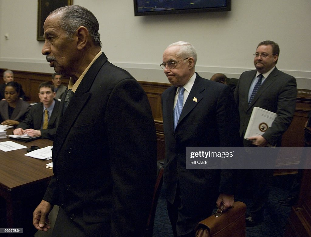 Chairman John Conyers, D-Mich., walks with Attorney General Michael Mukasey to the witness table as they arrive for the House Judiciary Committee hearing on oversight of the Justice Department on Thursday, Feb. 7, 2008.