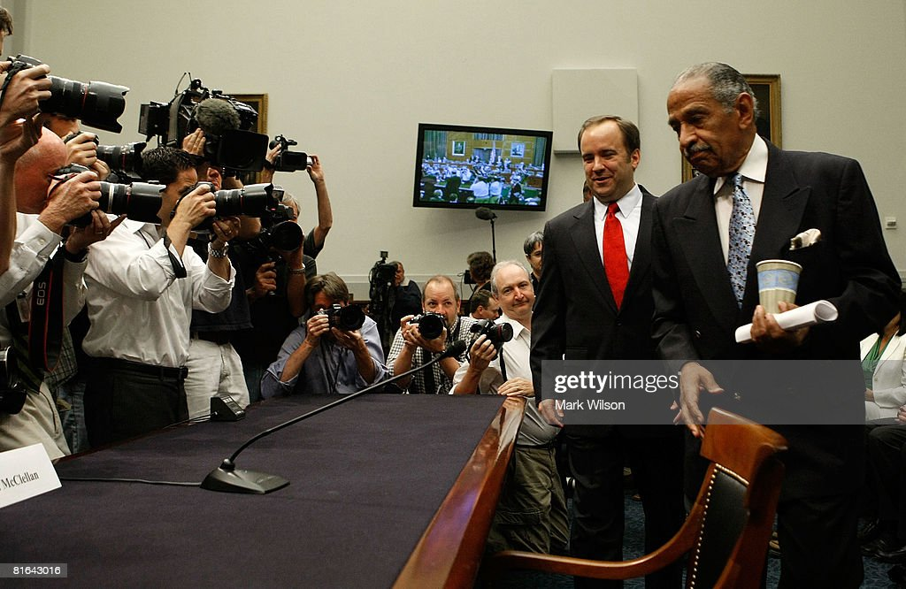 Chairman John Conyers (D-MI) (R) shows former White House Press Secretary Scott McClellan where to sit before the start of a House Judiciary Committee hearing on Capitol Hill, June 20, 2008 in Washington DC. The committee's focus is on reported attempts to cover up the involvement of White House officials in the leak of the covert identity of CIA officer Valerie Plame Wilson.