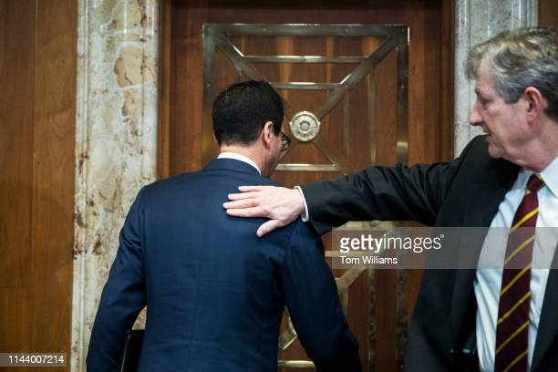 Chairman John Kennedy RLa right says goodbye to Treasury Secretary Steven Mnuchin after he testified during a Senate Appropriations Subcommittee on...