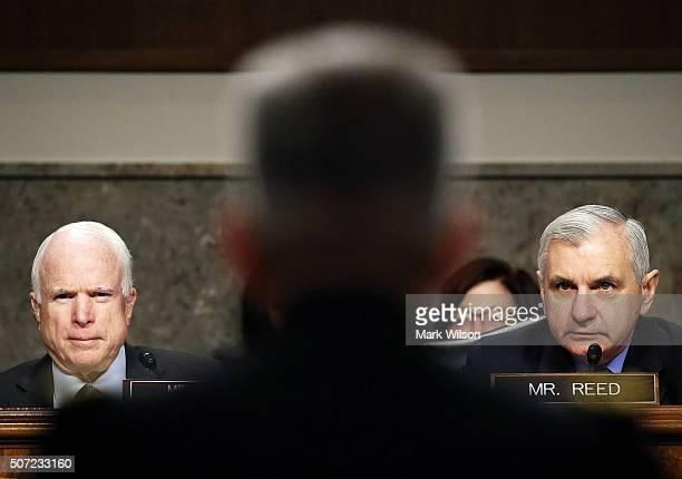 Chairman John McCain and Sen Jack Reed listen to Lt General John W Nicholson Jr speak during his confirmation hearing before the Senate Armed...
