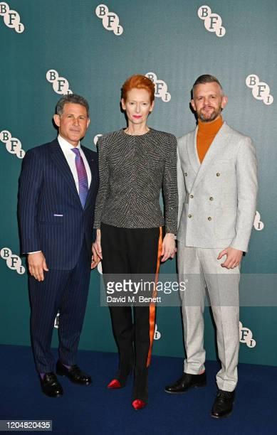 BFI Chairman Josh Berger Tilda Swinton and CEO of the BFI Ben Roberts attend the BFI Chairman's dinner awarding Tilda Swinton with a BFI Fellowship...