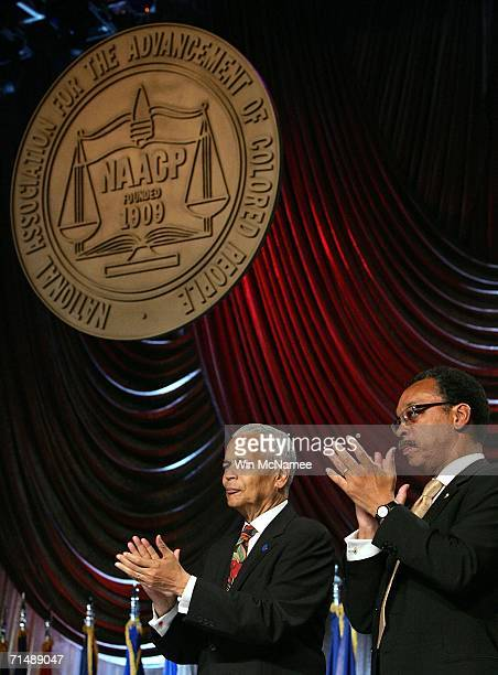 Chairman Julian Bond and NAACP President Bruce Gordon applaud US President George W Bush after Bush announced support for renewal of the Voting...