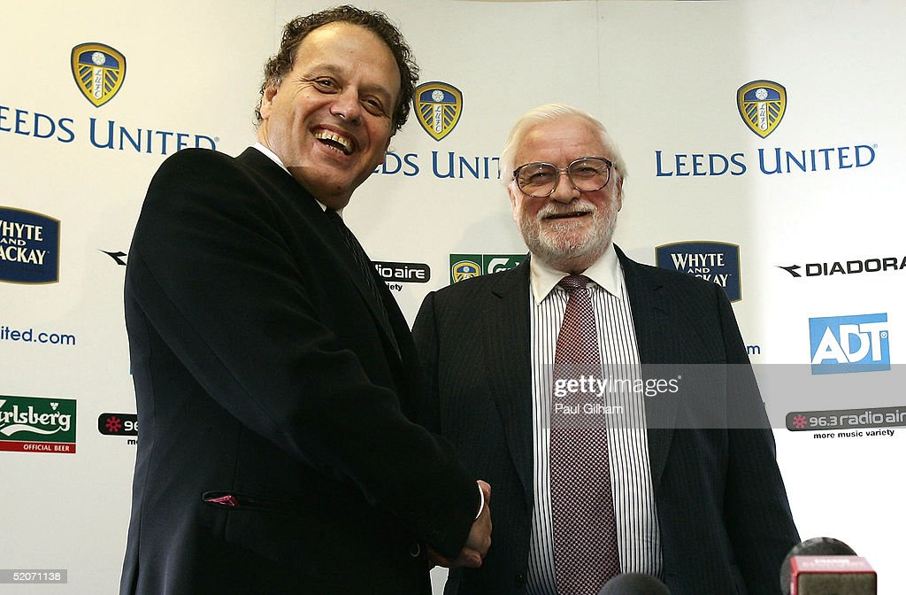 Chairman Ken Bates (R) of Leeds United shakes hand with outgoing chairman Gerald Krasner during a press conference at Elland Road Stadium on January 27, 2005 in Leeds, England.