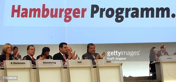 Chairman Kurt Beck SPD Secretary General Hubertus Heil German Labour Minister and Vice Chancellor Franz Muentefering and Baerbel Dieckmann applaud...