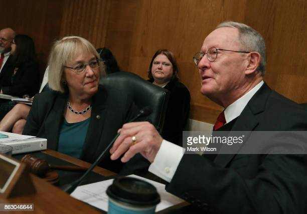 Chairman Lamar Alexander and ranking member Sen Patty Murray confer during a Senate Health Education Labor and Pensions committee hearing on Capitol...