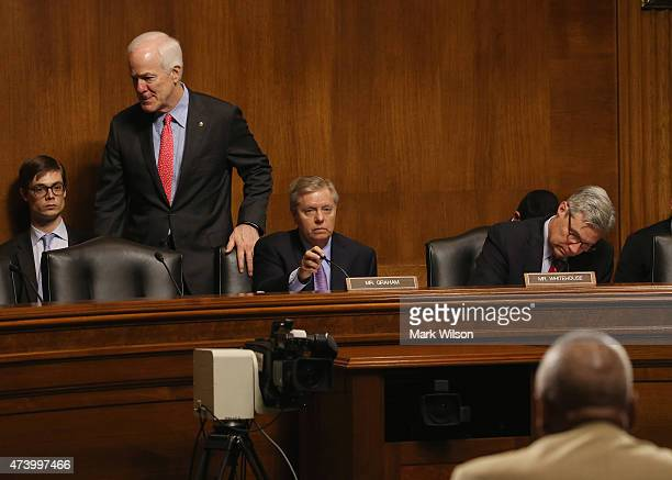 Chairman Lindsey Graham participates in a Senate Judiciary Subcommittee hearing while flanked by Sen John Cornyn and Sen Sheldon Whitehouse May 19...
