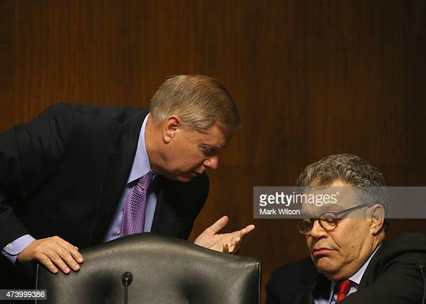 Chairman Lindsey Graham talks with Sen Al Franken during a Senate Judiciary Subcommittee hearing on the use of body cameras by law enforcement May 19...