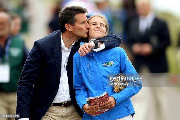 LOCOG chairman Lord Sebastian Coe with his daughter Alice on Day four of the FISA 2011 World Rowing Junior Championships at Eton Dorney on August 6...