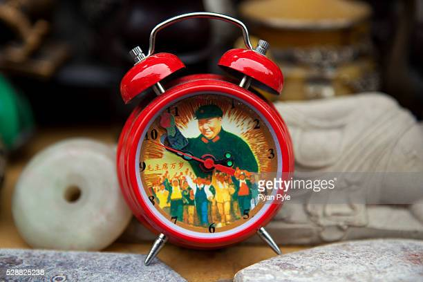 A Chairman Mao alarm clock on sale in the Dongtai Road Antique Market famous for old Buddhas and Communist trinkets in Shanghai China