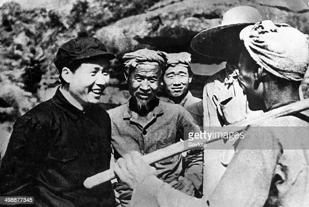 Chairman Mao speaking with peasants of Yangchialing in Yunan in Northern Shensi Province during the Second SinoJapanese War