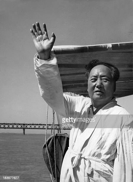 Chairman Mao standing on the deck of a motorboat reviewing swimmers on the Yangtze River. July 26, 1966.