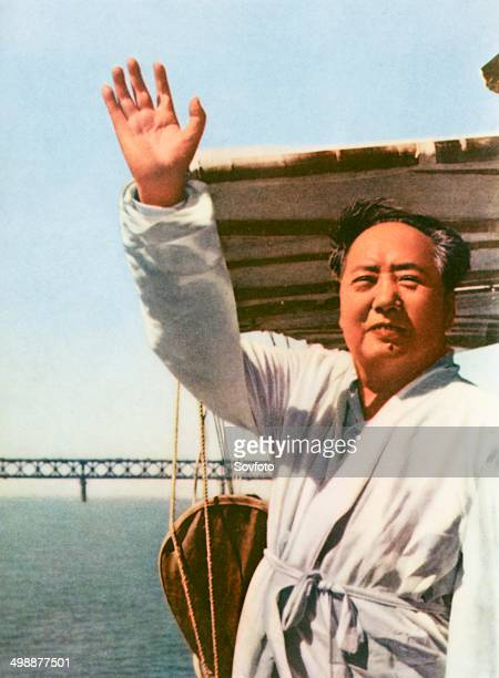 Chairman Mao standing on the deck of a motorboat reviewing swimmers on the Yangtze River July 26 1966