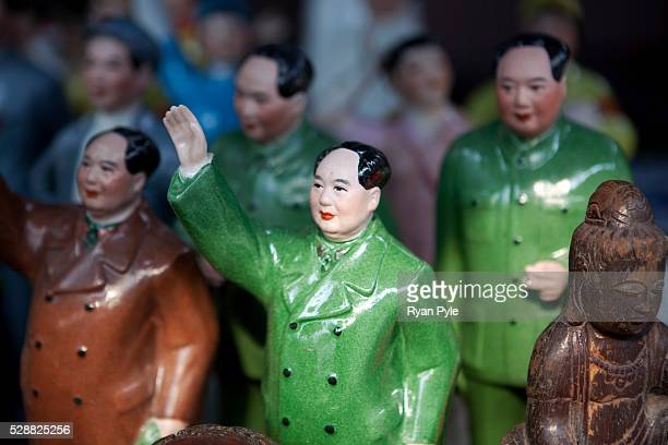 Chairman Mao statues for sale in the Dongtai Road Antique Market famous for old Buddhas and Communist trinkets in Shanghai China