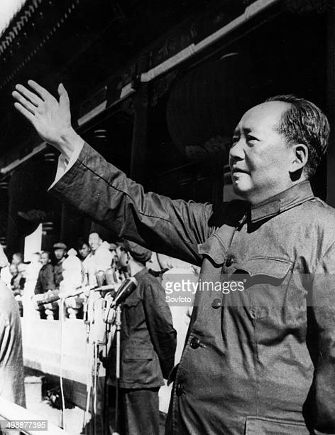 Chairman Mao Zedong addressing the crowd from the rostrum in Tienanmen Square as he reviews paraders taking part in the grand rally celebrating the...