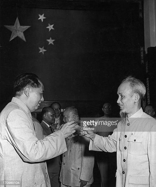 Chairman mao zedong and president ho chi minh of the democratic republic of vietnam toast the signing of the joint communique between their countries...