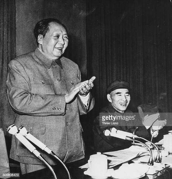 Chairman Mao Zedong , President of the People's Republic of China, with Vice President Lin Biao sitting next to him, speaking at the Ninth Congress...