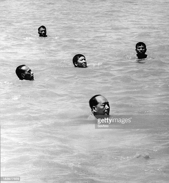 Chairman Mao Zedong swimming in the Yangtze River China July 26 1966 Other swimmers are Chinese security men