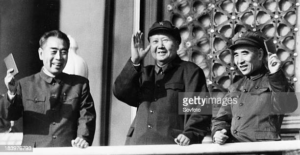 Chairman Mao Zedong with Zhou Enlai and Lin Piao 'review the great contingents of the cultural revolution on the Tienanmen rostrum' Beijing China...