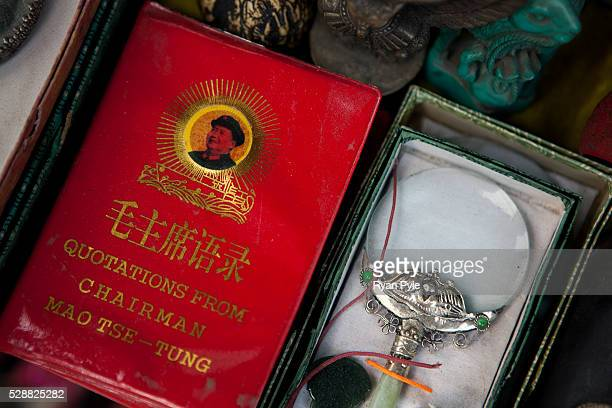 Chairman Mao's book for sale in the Dongtai Road Antique Market famous for old Buddhas and Communist trinkets in Shanghai China