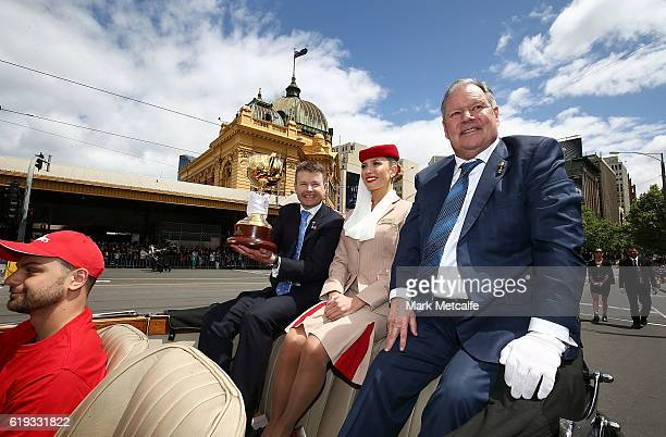 Chairman Michael Burn holds aloft the Melbourne Cup during the 2016 Melbourne Cup Parade on October 31 2016 in Melbourne Australia