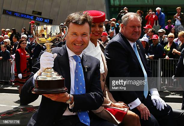 Chairman Michael Burn holds the Melbourne Cup alongside Lord Mayor of Melbourne Robert Doyle during the 2013 Melbourne Cup Parade on November 4 2013...