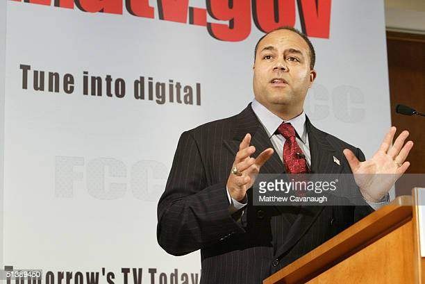 Chairman Michael Powell gestures as he speaks at a press conference at FCC headquarters October 4 2004 in Washington DC Powell unveiled a new online...