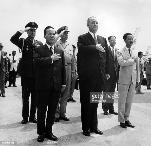Chairman Nguyen Van Thieu President Lyndon B Johnson and Prime Minister Nguyen Cao Ky salute during the playing of the US and Vietnamese National...