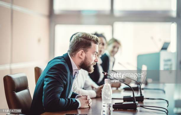 chairman of a conference event - chairperson stock pictures, royalty-free photos & images
