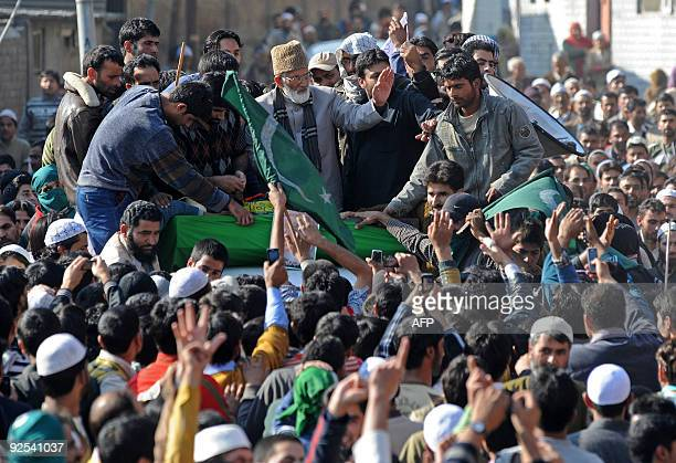 Chairman of a hardline faction of The All Parties Hurriyat Conference chairman Syed Ali Shah Geelan waves as he arrives to address a public rally in...