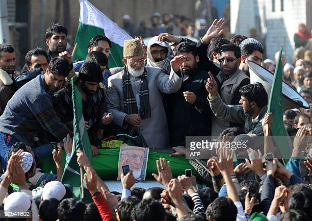 Chairman of a hardline faction of The All Parties Hurriyat Conference chairman Syed Ali Shah Geelani waves as he arrives to address a public rally in...