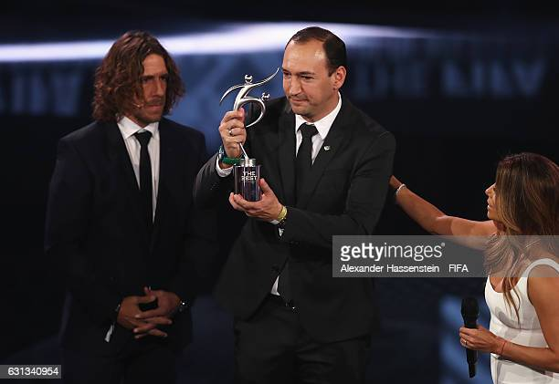 Chairman of Atletico National Juan Carlos de la Cuesta accepts the FIFA Fair Play Award from Carlos Puyol during The Best FIFA Football Awards at TPC...