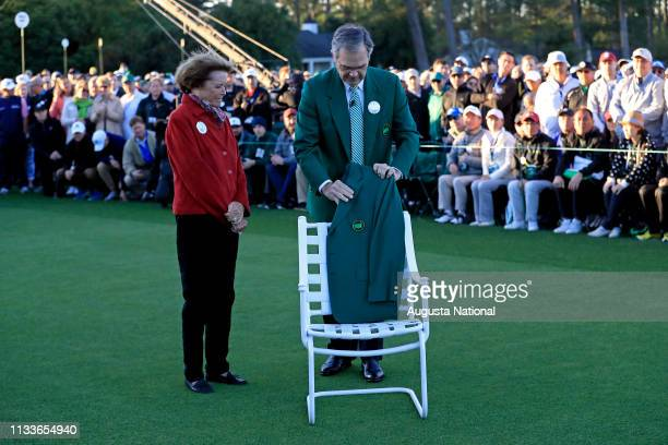 Chairman of Augusta National Golf Club and the Masters Tournament Billy Payne and Kathleen Gawthrop the wife of Masters champion Arnold Palmer place...