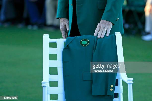 Chairman of Augusta National Golf Club and the Masters Tournament Billy Payne places his hand on the Green Jacket that was placed on a chair on the...