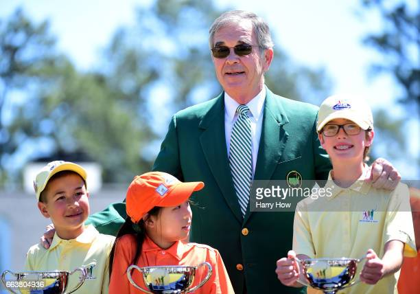 Chairman of Augusta National Golf Club Billy Payne poses with overall winner's during the Drive Chip and Putt Championship at Augusta National Golf...