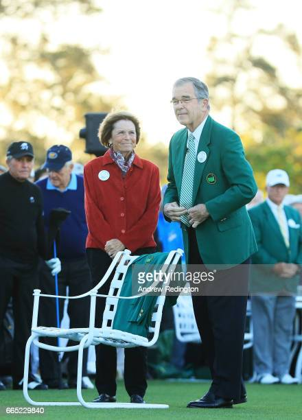 Chairman of Augusta National Golf Club William Porter 'Billy' Payne and Kathleen 'Kit' Palmer place a Green Jacket on a chair in honor of Arold...