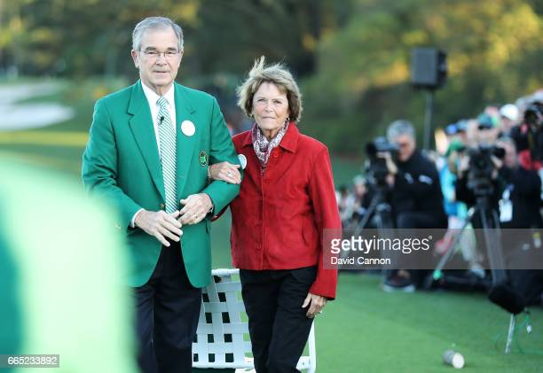 Chairman of Augusta National Golf Club William Porter 'Billy' Payne and Kathleen 'Kit' Palmer walk back after placing a Green Jacket on a chair in...