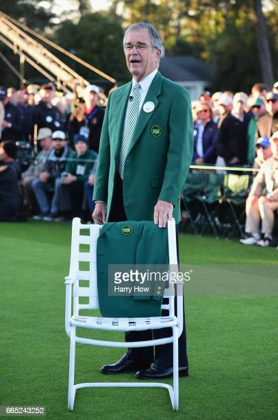 Chairman of Augusta National Golf Club William Porter 'Billy' Payne stands next to a Green Jacket on a chair in honor of Arold Palmer during the...