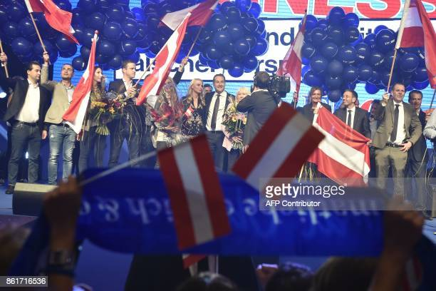 TOPSHOT Chairman of Austria's farright Freedom Party HeinzChristian Strache and his wife Philippa Beck celebrate after the results of the general...