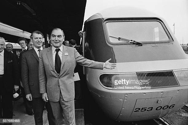 Chairman of British Rail Peter Parker stands beside a British Rail class 253 Inter City 125 high speed train at Cardiff Central station after a...