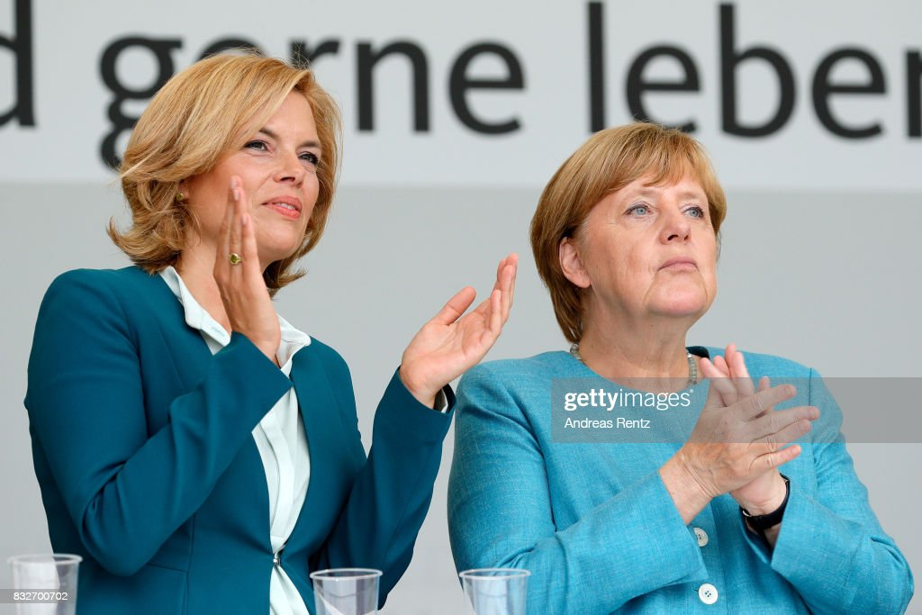 Chairman of CDU Rheinland-Pfalz Julia Kloeckner and German Chancellor and head of the German Christian Democrats (CDU) Angela Merkel are seen on stage at an election rally at the headland known as the 'Deutsches Eck' ('German Corner'), where the Mosel and Rhine rivers meet, on August 16, 2017 in Koblenz, Germany. Germany is scheduled to hold federal elections on September 24 and Merkel, who is running for a fourth term as chancellor, currently holds a double-digit lead over Martin Schulz from the German Social Democrats (SPD), her main opponent.