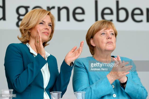 Chairman of CDU RheinlandPfalz Julia Kloeckner and German Chancellor and head of the German Christian Democrats Angela Merkel are seen on stage at an...