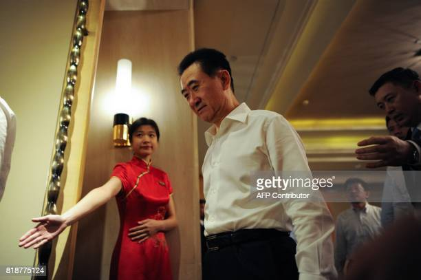 Chairman of China's Wanda Group Wang Jianlin attends the signing ceremony for the strategic partnership between Wanda Group, Sunac and R&F Properties...