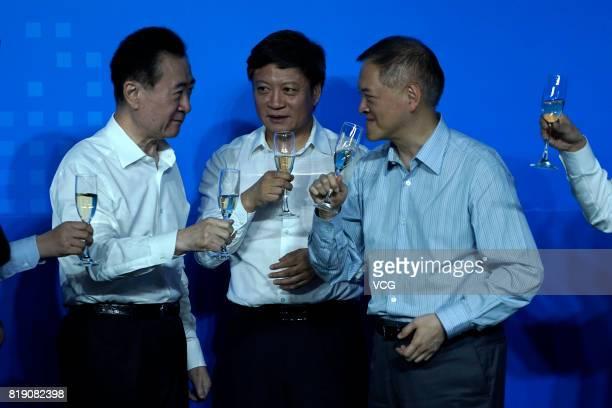 Chairman of China's Wanda Group Wang Jianlin shares a toast with chairman of Sunac China Holdings Limited Sun Hongbin and chairman of R&F Properties...
