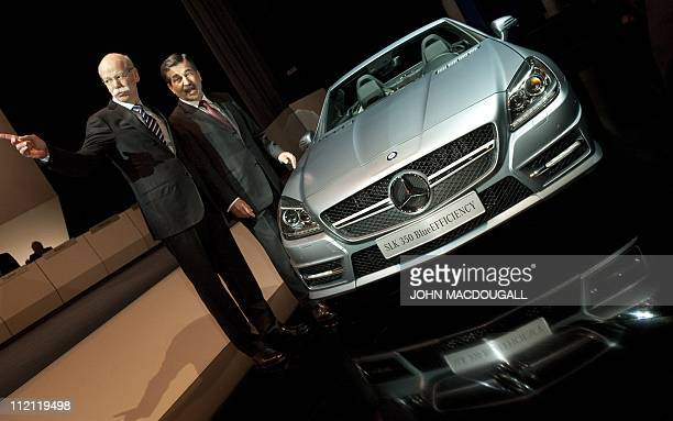 Chairman of Daimler's supervisory board Manfred Bischoff and Daimler CEO Dieter Zetsche pose next to a Mercedes SLK 350 model prior to the start of...