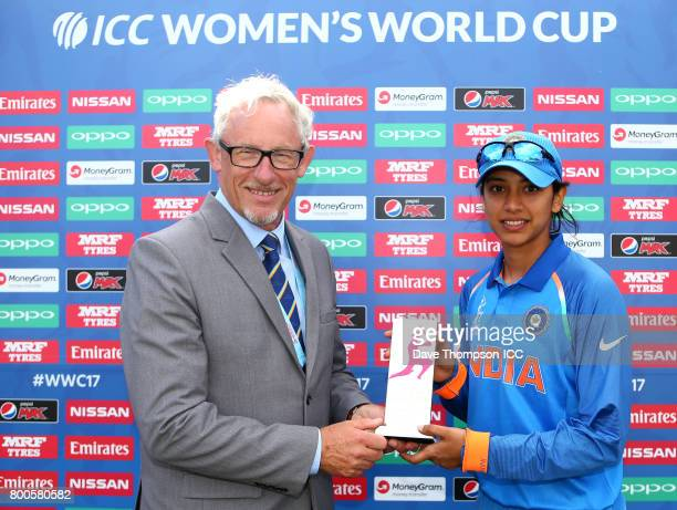 Chairman of Derbyshire County Cricket Club Ian Morgan presents the player of the match trophy to Smriti Mandhana of India following the ICC Women's...