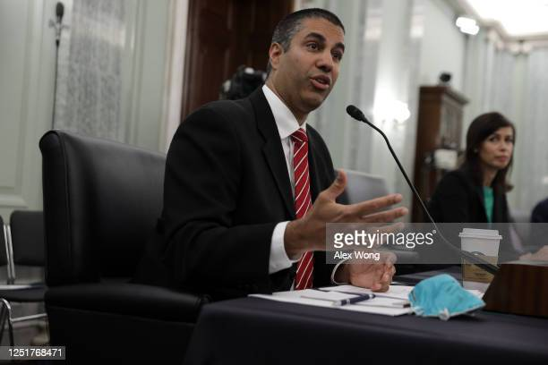 Chairman of Federal Communications Commission Ajit Pai testifies as commissioner of Federal Communications Commission Jessica Rosenworcel listens...